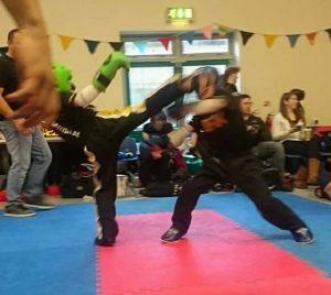Kailem Mulligan landing a spinning hook kick