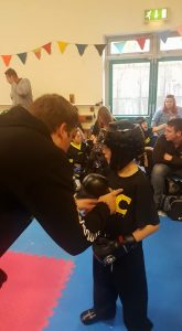 Peter Lonsdale listening to instructions from coach Matt Roberts at the BBBA