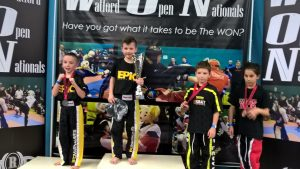 Alex Fellender-Evans (left) and Harvey Tyler (middle) on the WON podium